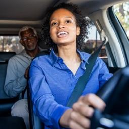 Female driving in car