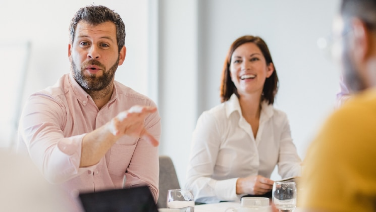 Male and female talking in business meeting
