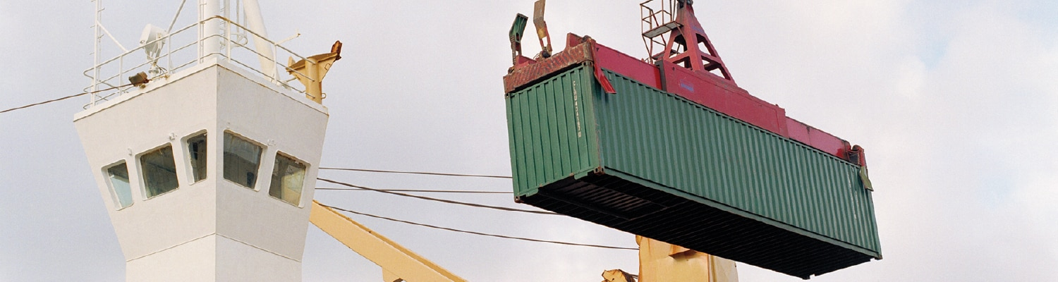 Crane moving shipping container