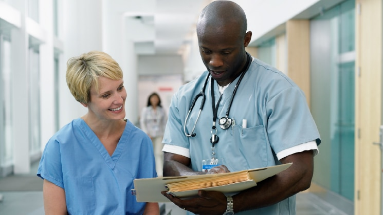 Two healthcare professionals talking